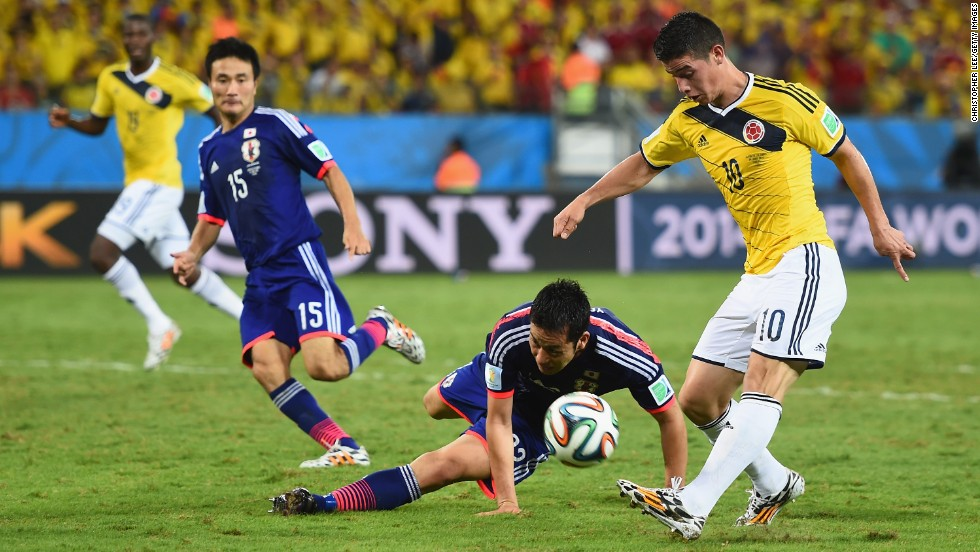 James Rodriguez of Colombia shoots and scores his team's fourth goal against Japan on June 24 in Cuiaba, Brazil. Colombia won 4-1.