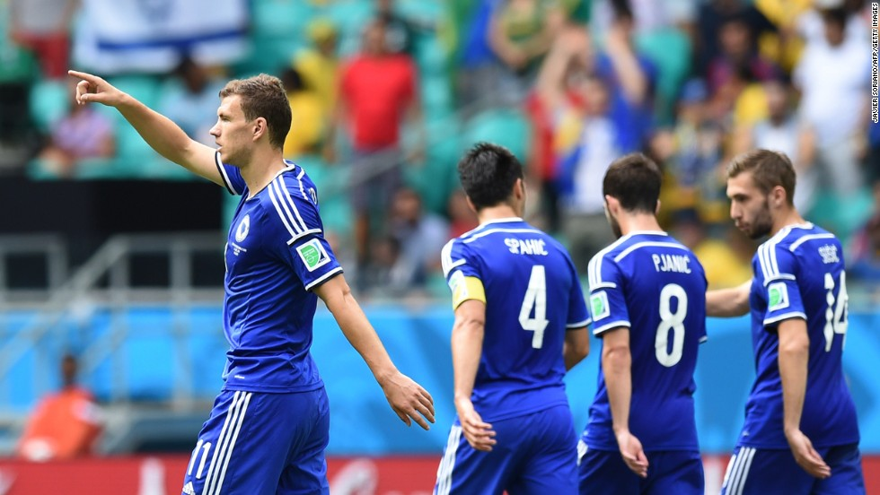 Bosnia-Herzegovina forward Edin Dzeko, left, celebrates scoring his team's first goal against Iran.
