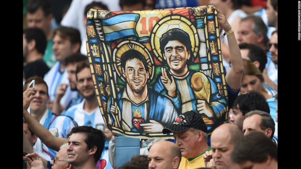 "A fan holds an image of Argentina forward Lionel Messi and the legendary Diego Maradona depicted as religious icons. <a href=""http://www.cnn.com/2014/06/24/football/gallery/world-cup-0624/index.html"">See the best World Cup photos from June 24.</a>"