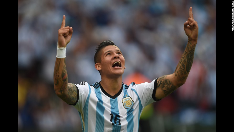 Argentina defender Marcos Rojo celebrates his team's third goal against Nigeria in Porto Alegre, Brazil, on June 25. Argentina won 3-2.