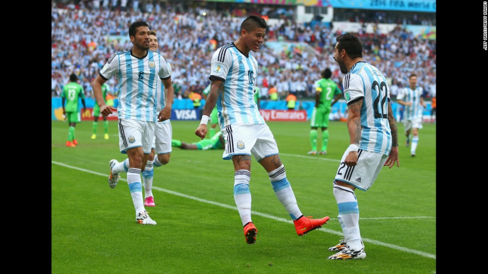 Marcos Rojo of Argentina, center, celebrates scoring his team's third goal with Ezequiel Garay, left and Ezequiel Lavezzi.