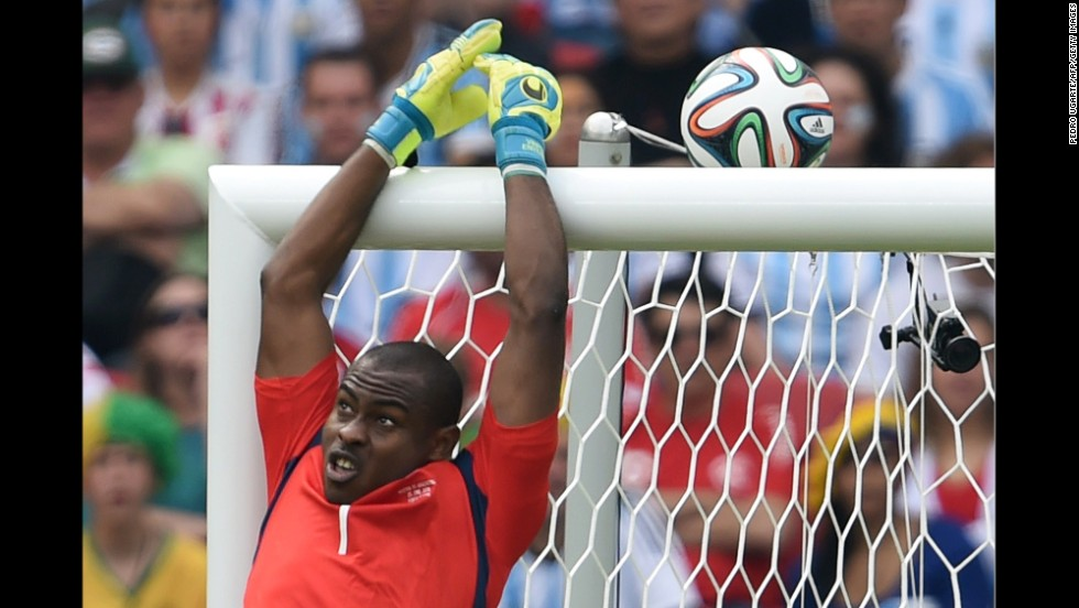 Nigeria's goalkeeper Vincent Enyeama jumps to block the ball.