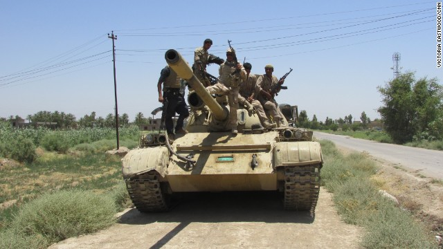 A Soviet era tank on its way to a position where Iraqi soldiers say there is a sniper.