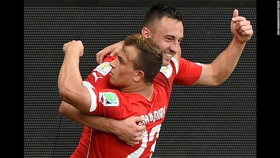 Shaqiri celebrates with forward Drmic, back, after scoring his team's second goal against Honduras.