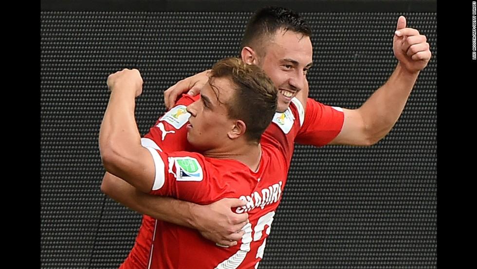 Shaqiri celebrates with forward Drmic, back, after scoring his team's second goal against Honduras.