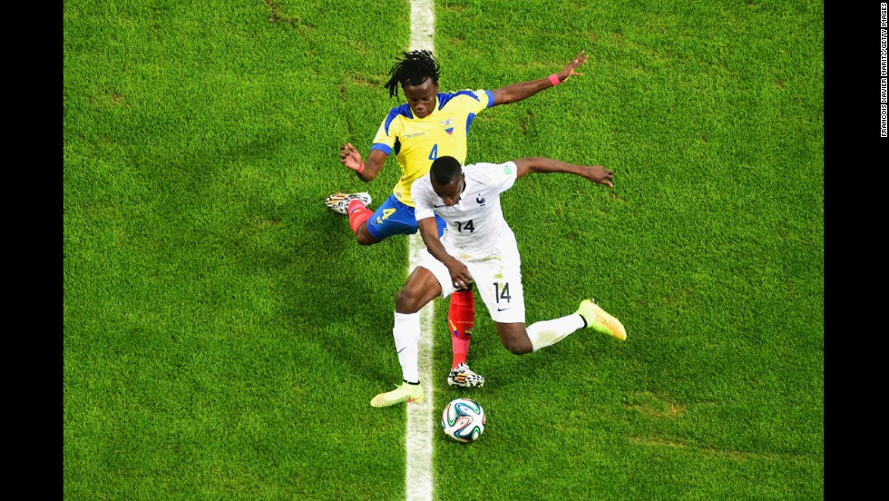 Blaise Matuidi of France controls the ball against Juan Carlos Paredes of Ecuador.