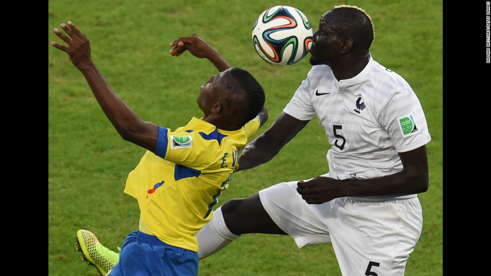 Ecuador's Enner Valencia, left, and France's Mamadou Sakho vie for the ball.