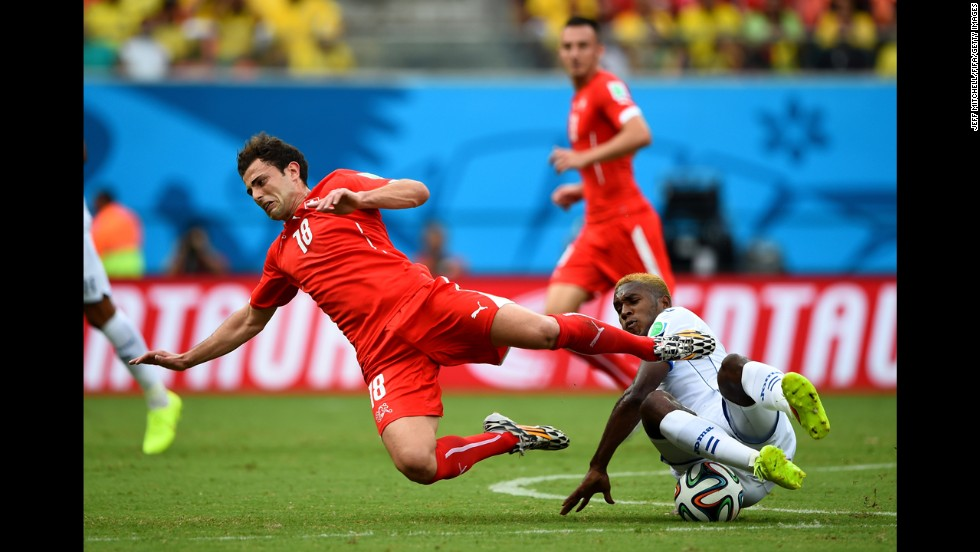 Admir Mehmedi of Switzerland is tackled by Brayan Beckeles of Honduras on June 25 in Manaus, Brazil. Switzerland won 3-0.