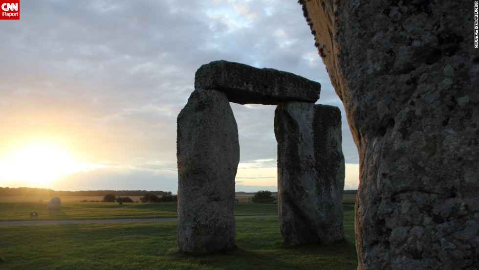 "The clouds break through on a mild July evening at Stonehenge to illuminate the sarsen stones, providing ""a brilliant summer backdrop to this amazing place,"" said <a href=""http://ireport.cnn.com/docs/DOC-1145557"">Ken Arbuckle</a>, who captured this image during a July 2011 vacation."