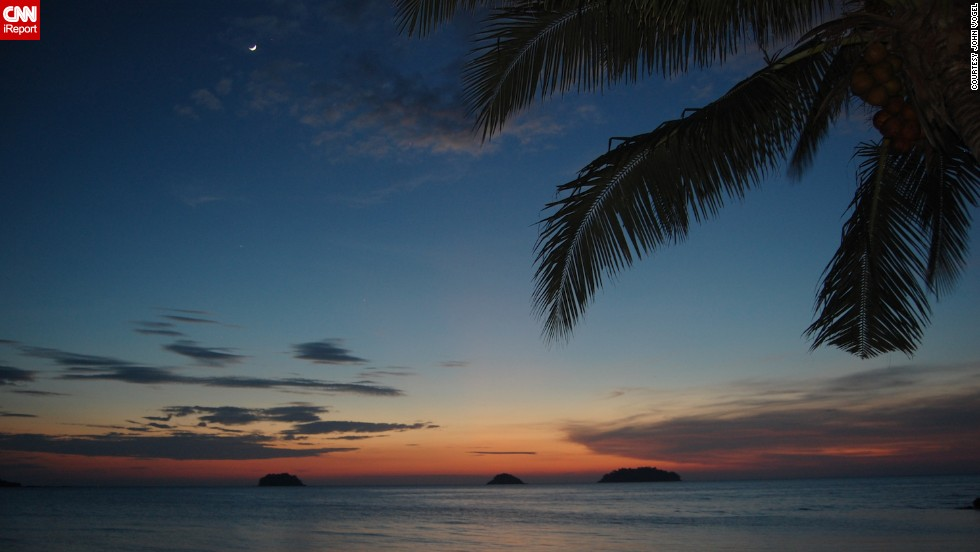 "The sun sets over the Andaman Sea off the coast of <a href=""http://ireport.cnn.com/docs/DOC-1145792"">Phuket, Thailand</a>, in July 2013, as seen in this photo by John Vogel."