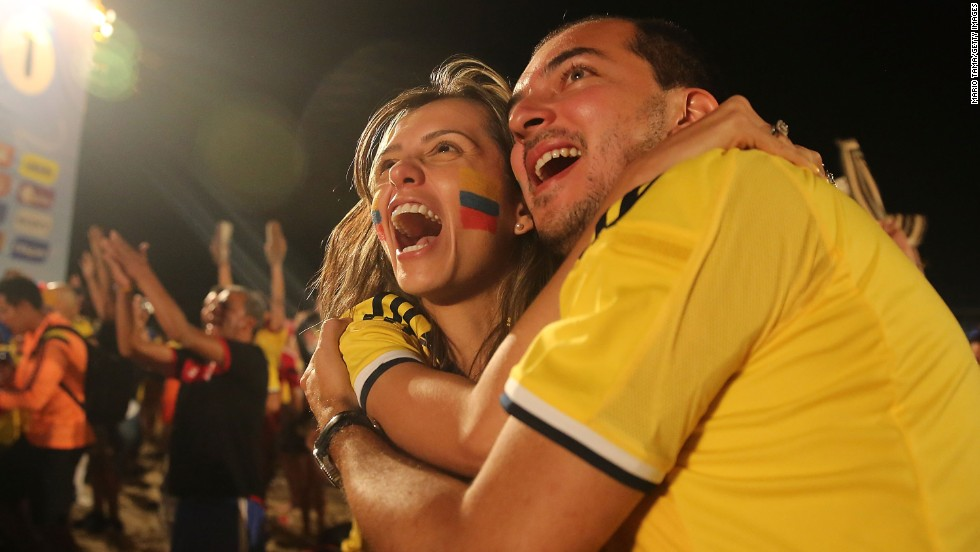 Colombia supporters at the FIFA Fan Fest on Copacabana Beach embrace and celebrate a World Cup win over Japan on Tuesday, June 24.