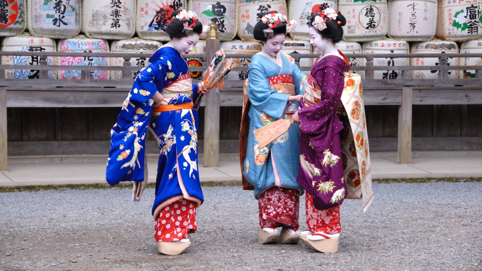 Sometimes, maiko will wear high platform wooden slippers as seen here. Geisha always wear flat ones.