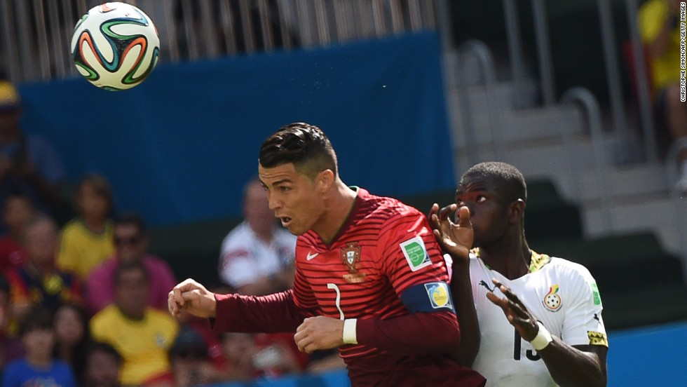 Portugal forward Cristiano Ronaldo and Ghana defender Jonathan Mensah vie for the ball.