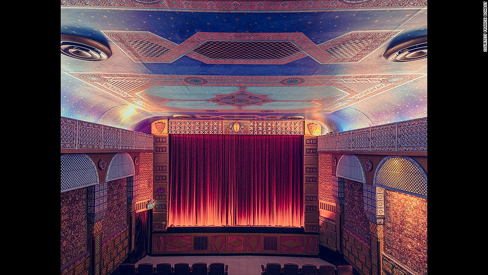 "<em>Grand Lake Theater, Oakland</em><br /><br />The majority of cinemas Bohbot visited were built during the first half of the 20th century, with an ornate art deco design which stands in sharp contrast to the pared-down and largely identikit look of a contemporary cineplex: ""Nowadays the technology is amazing and let's you watch a movie on a big screen in a comfortable seat, but sometimes the majestic details of the facade, the lobby and even the curtains can really add to the pleasure,"" explains Bohbot."