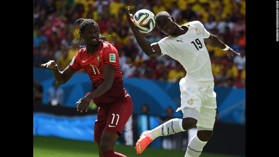 Eder of Portugal and Jonathan Mensah of Ghana jump for the ball.