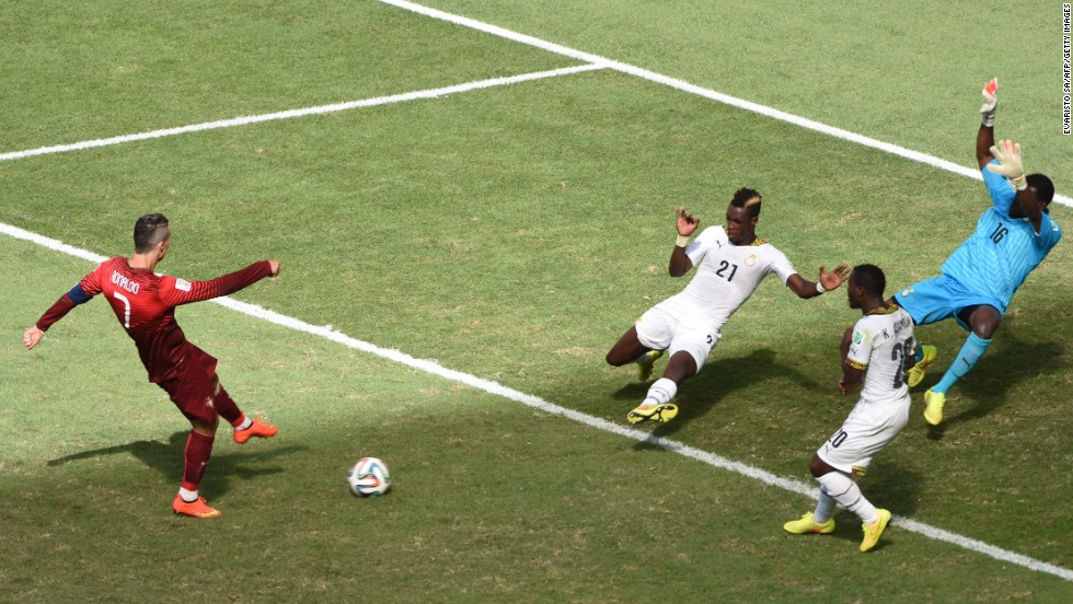 Portugal's Christiano Ronaldo, left, strikes the ball to score a goal against Ghana.