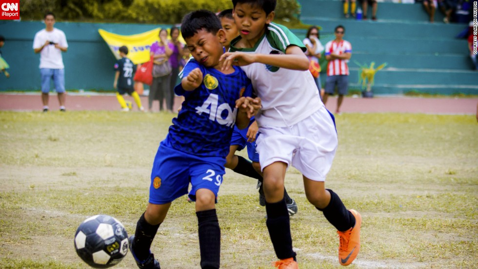 "These kids ""have their game faces on"" as they <a href=""http://ireport.cnn.com/docs/DOC-1136525"">fight for the ball</a> in Cebu, Philippines, says Clarson Fruelda. They're playing in an annual local soccer tournament with divisions for all ages."