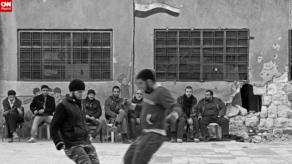 "A group of Free Syrian Army fighters in Aleppo, Syria, takes a break for a <a href=""http://ireport.cnn.com/docs/DOC-1143212"">quick game of pick-up soccer</a>. Photographer Reynaldo Leal captured the game while documenting the conflict in Syria in 2013."
