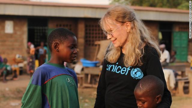 Mia Farrow meets brothers Oumarou and Adamou Bouba, 13 and 10, at the Bossangoa camp