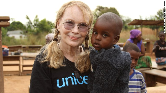 Mia Farrow carries Moussa Ibrahim at the Bossangoa camp in the Central African Republic