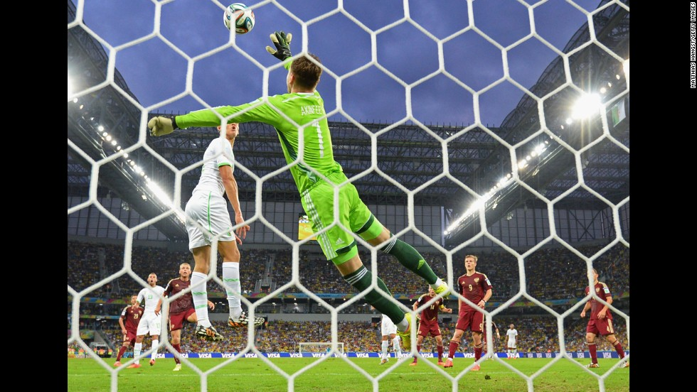 Igor Akinfeev of Russia makes a save against Algeria.