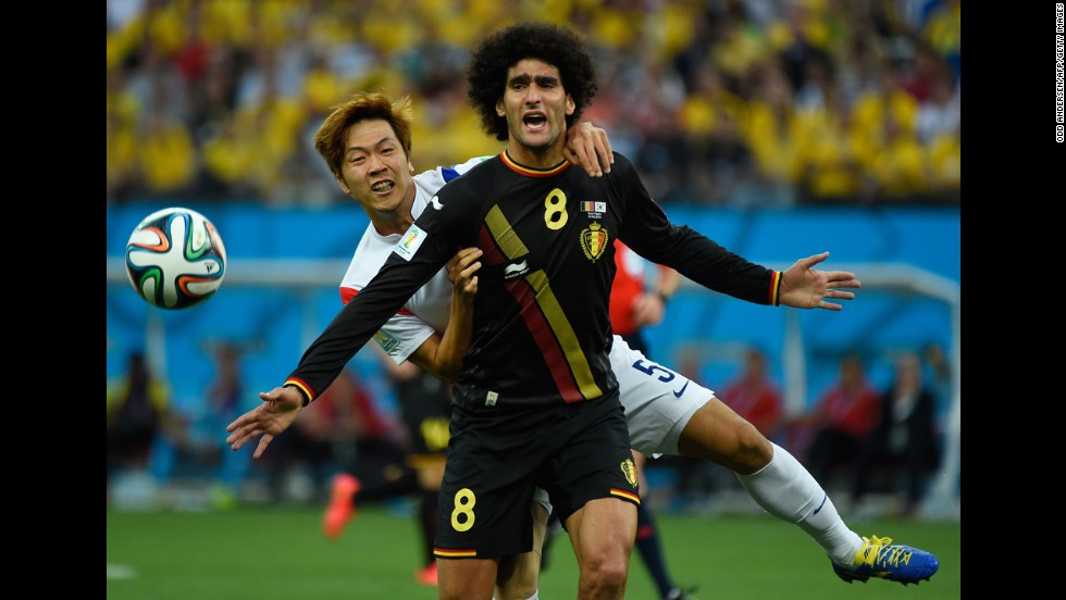 Young-Gwon, left, vies with Belgium midfielder Marouane Fellaini.