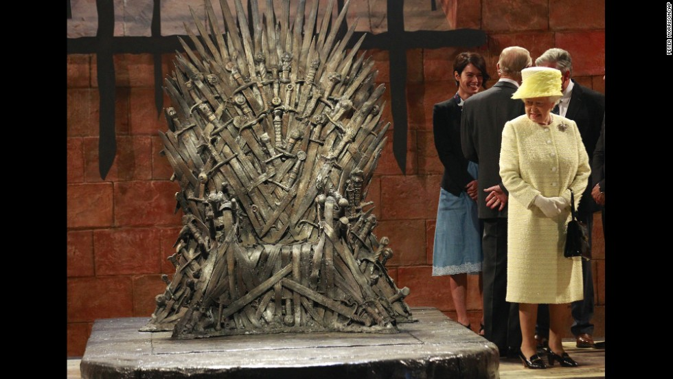 "Britain's Queen Elizabeth II visits the set of ""Game of Thrones"" in Belfast, Northern Ireland, on Tuesday, June, 24."