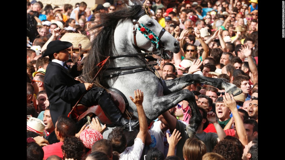 A rider rears up on his horse while surrounded by a cheering crowd on Monday, June 23, during the Saint John festival in downtown Ciutadella on the Spanish Balearic island of Menorca.