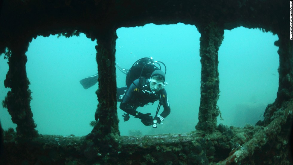 A diver swims near the Baron Gautsch shipwreck off the coast of Rovinj, Croatia, on Sunday, June 22. The Austro-Hungarian steamboat sank 100 years ago this August.