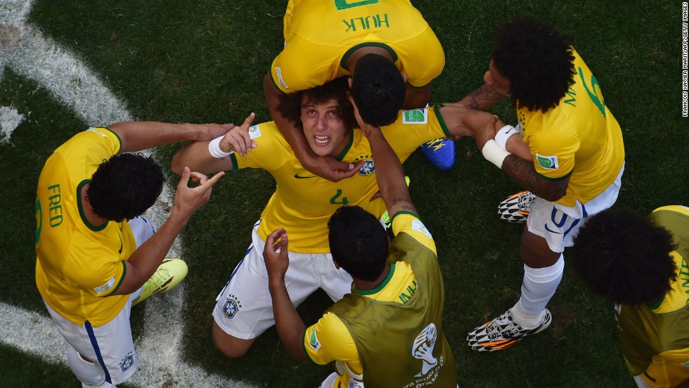 Brazil defender David Luiz is surrounded by teammates after a first-half goal against Chile during a World Cup match Saturday, June 28, in Belo Horizonte, Brazil. The goal was later determined to have gone off Chile's Gonzalo Jara. Brazil won the match on penalty kicks to advance to the quarterfinals.
