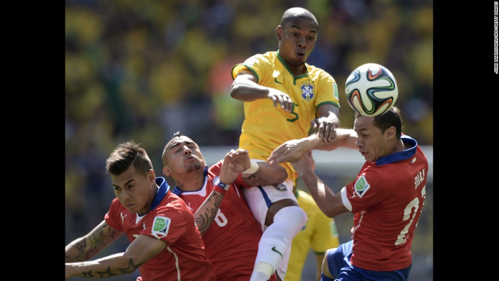 From left: Chile's Eduardo Vargas, Chile's Arturo Vidal, Brazil's Marcelo and Chile's Marcelo Diaz vie for the ball.