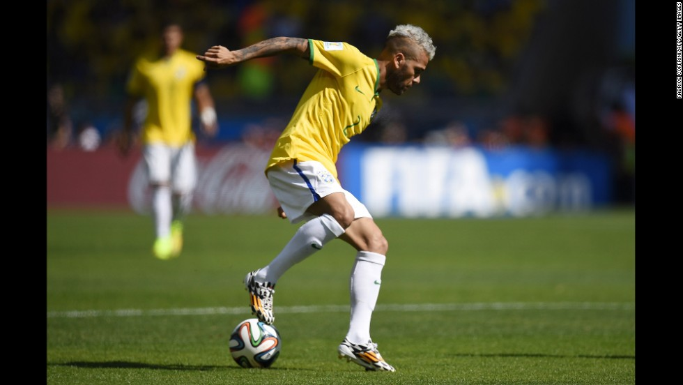 Brazilian defender Dani Alves controls the ball.