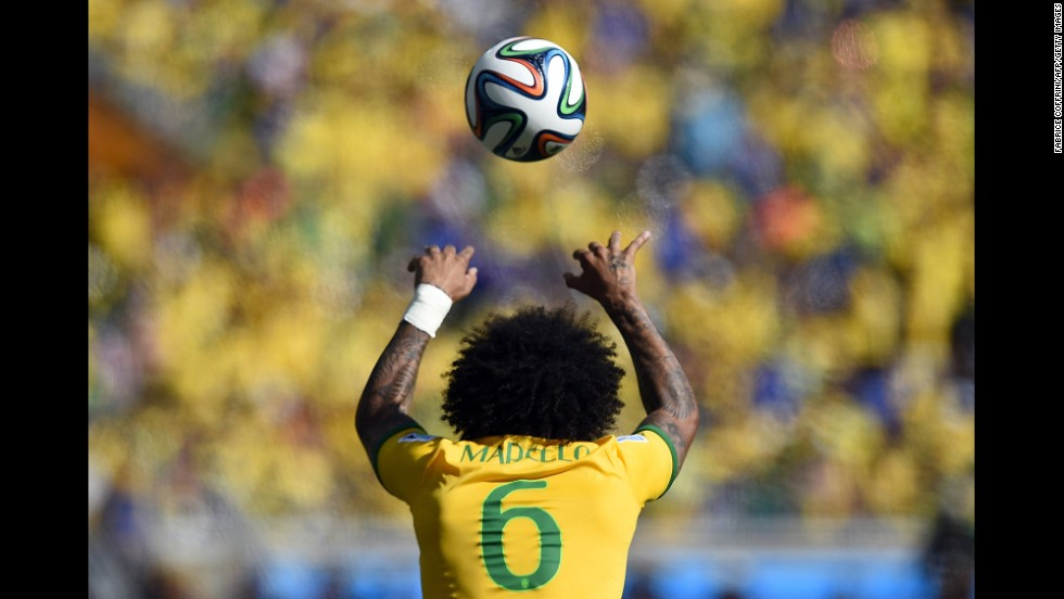 Brazil's defender Marcelo throws the ball in during the game.