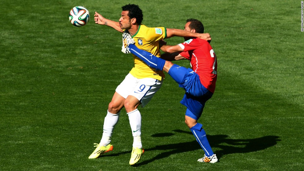 Fred of Brazil is challenged by Marcelo Diaz of Chile.