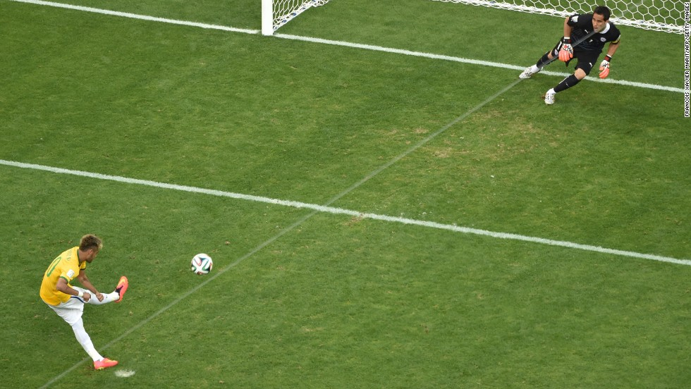 Brazil's Neymar scores during the penalty shootout.