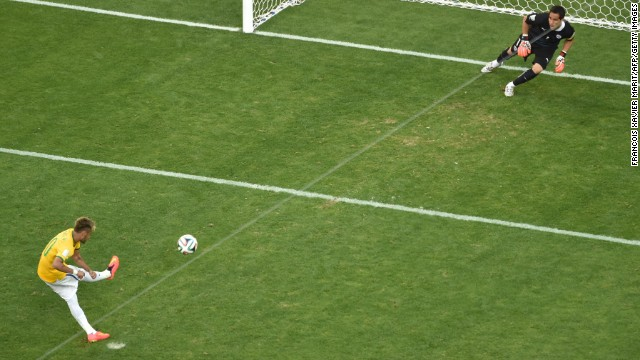 Brazil's Neymar scores during the penalty shootout.