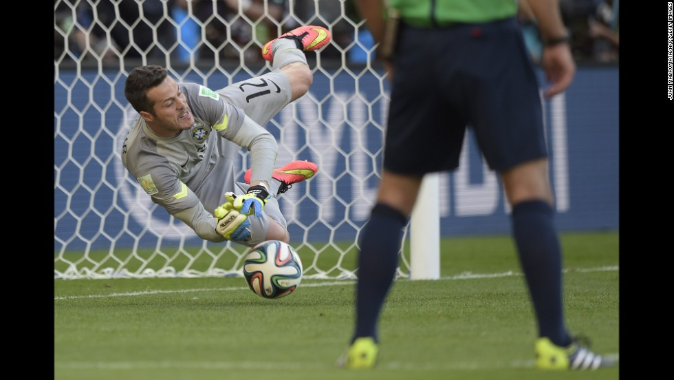 Brazil's goalkeeper Julio Cesar makes a save during the penalty shootout.