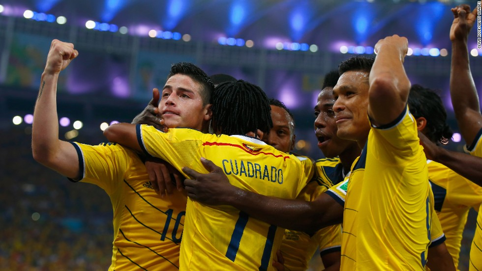 James Rodriguez of Colombia, left, celebrates scoring his team's second goal against Uruguay in Rio de Janeiro on Saturday, June 28. Colombia won the game 2-0 to advance to the quarterfinals. Rodriguez had both goals.