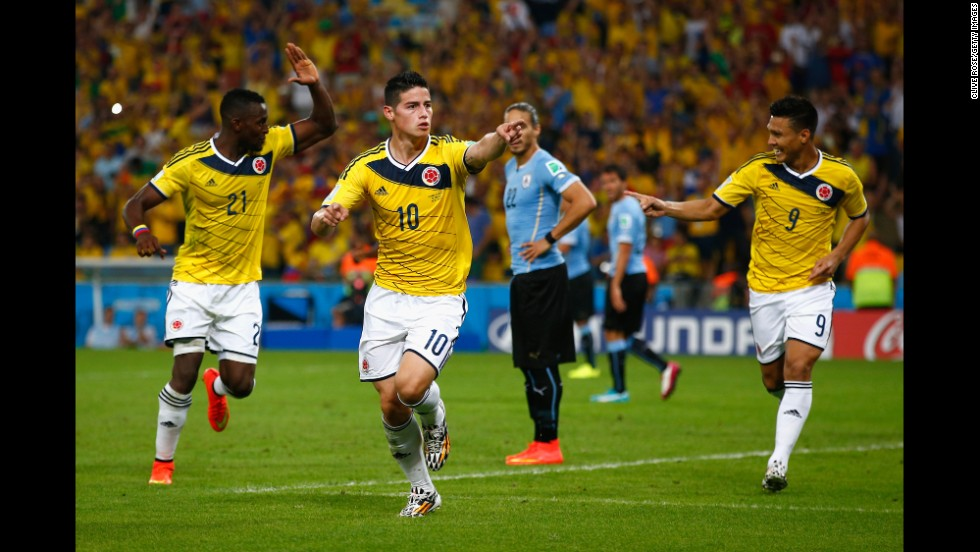 James Rodriguez of Colombia, center, celebrates scoring his team's second goal and his second during the World Cup game between Colombia and Uruguay in Rio de Janeiro on Saturday, June 28. Rodriguez set the record of most goals by one player in this World Cup with five goals to his name.