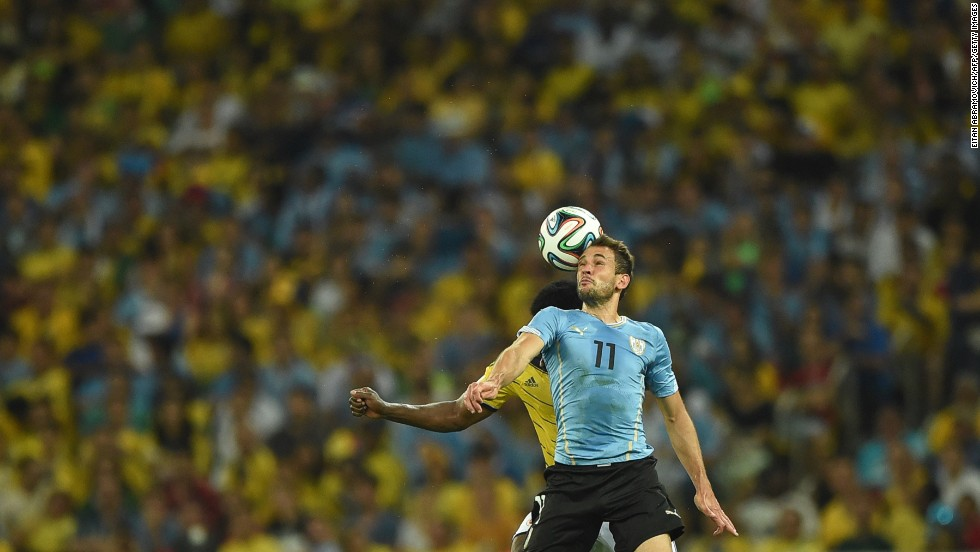 Uruguay's forward Christian Stuani heads the ball.