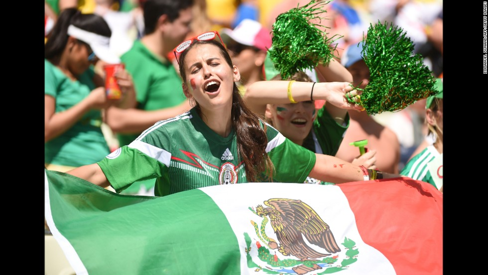 """Mexican supporters cheer for their team before the game. <a href=""""http://www.cnn.com/2014/06/28/football/gallery/world-cup-0628/index.html"""" target=""""_blank"""">See the best World Cup photos from June 28.</a>"""