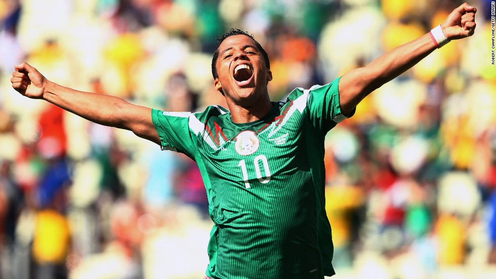 Giovani dos Santos of Mexico celebrates scoring his team's goal against the Netherlands.