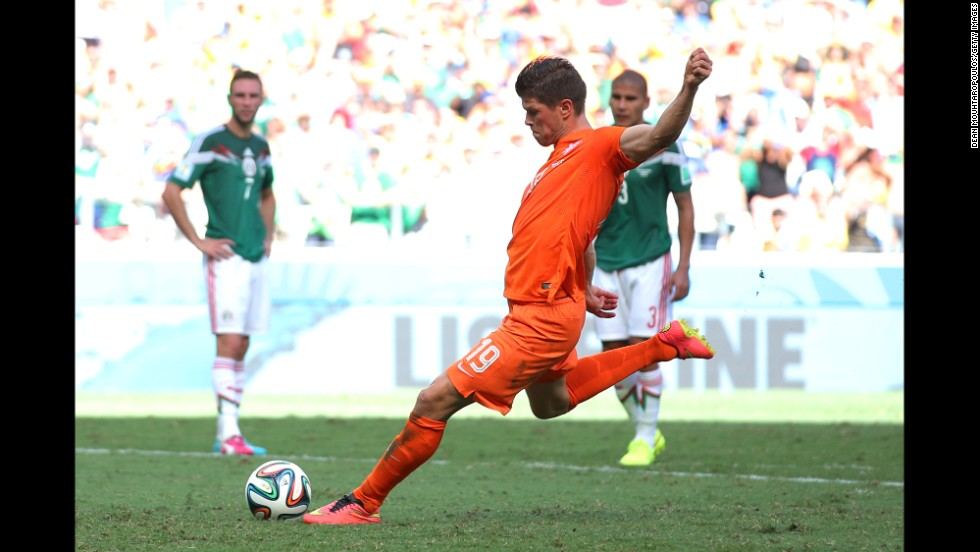 Klaas-Jan Huntelaar of the Netherlands shoots and scores his team's second goal on a stoppage-time penalty kick during a World Cup game against Mexico in Fortaleza, Brazil, on June 29. The Netherlands won 2-1 to advance to the quarterfinals.