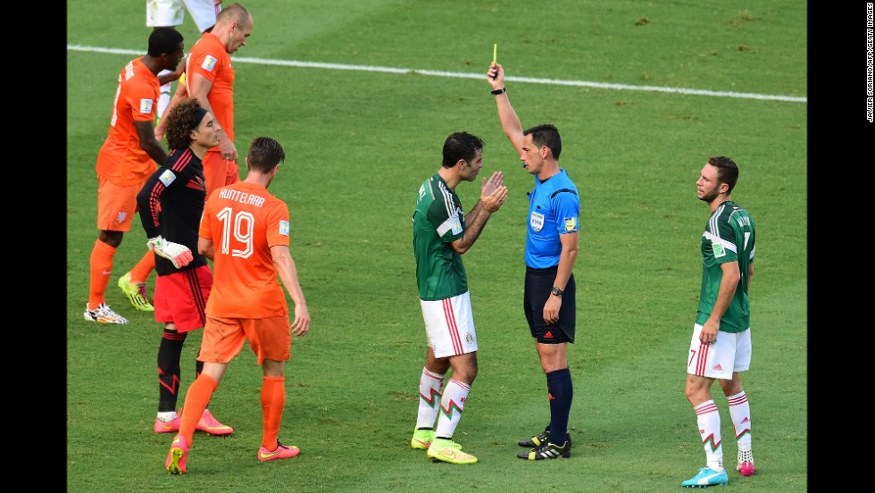 Mexico's captain, Rafael Marquez, is shown a yellow card by referee Pedro Proenca Oliveira Alves Garcia, which led to Huntelaar's penalty kick.