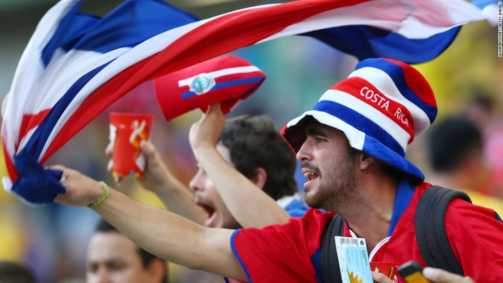 A Costa Rica fan enjoys the atmosphere of Pernambuco Arena in Recife, Brazil, before the game between Costa Rica and Greece.