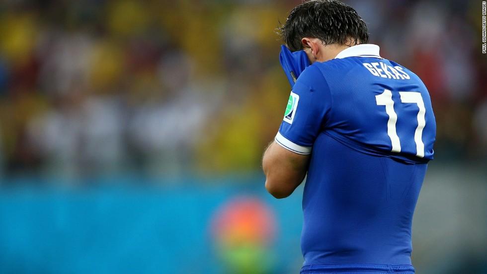 Theofanis Gekas of Greece walks away after having his shot blocked by Costa Rica's goalkeeper in a penalty shootout.
