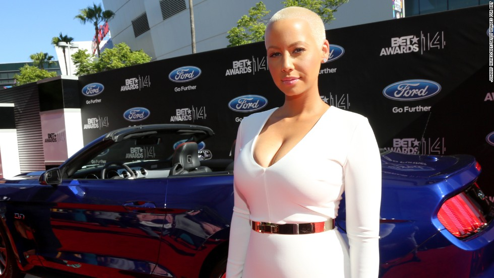 Amber Rose arrives at the BET Awards at the Nokia Theatre on Sunday, June 29, 2014, in Los Angeles. Take a look at the other stars as they arrive.