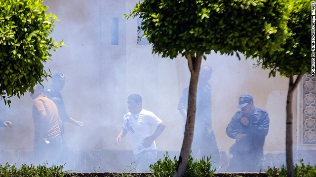 Smoke billows moments after a bomb blast in the vicinity of the Ittihadiya Palace in Cairo, on June 30, 2014.
