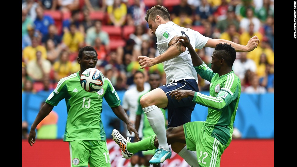 Oshaniwa, left, and Kenneth Omeruo, right, challenge French forward Olivier Giroud.