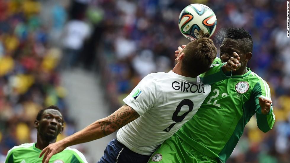 Giroud heads the ball near Omeruo.